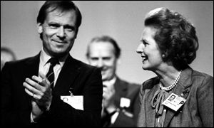 Archer, left, applauding; Thatcher, right
