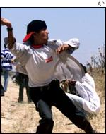 Palestinian throwing stones in Gaza