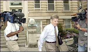 Congressman Gary Condit is followed by the media when leaving his house