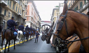 Genoa's streets are deserted as police await the protesters