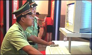 Chinese police at computer screen