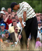 Tiger Woods tees off at the fourth