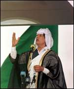 [ image: Colonel Gadhafi delivers a sermon]