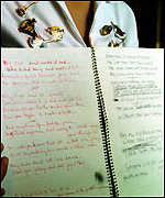 [ image: Lyrics and instructions fill the notebook]