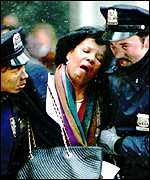 [ image: New York police help a wounded citizen]