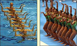 Ukraine compete while Russia celebrate their victory in the women's synchronised swimming event