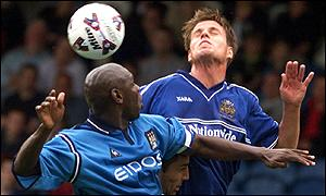 Man City's Shaun Goater and Halifax Town's Paul Harsley