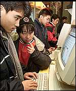 People using an internet cafe