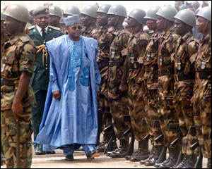 Sani Abacha inspects a military guard