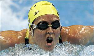 Petria Thomas of Australia powers through the water to win the final of the womens 200m butterfly