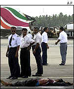 Airport officials with body of guerrilla