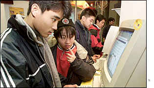 Young Chinese people surf the net