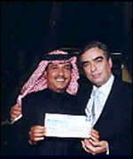 Millionaire winner with host George Kurdahi (courtesy of MBC)