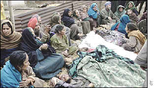 Villagers in Chati Singhpura Mattan, near Srinagar, grieve over a massacre of Sikh villagers
