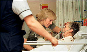 Nurse tends elderly patient