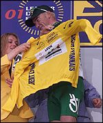 Stuart O'Grady dons the leader's yellow jersey