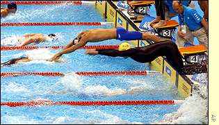 Australia's Ian Thorpe (yellow cap)  won his sixith gold medal  after the  Australian's  won the 4x100m medley relay