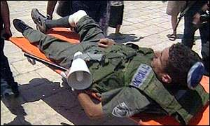 injured Israeli policeman on stretcher