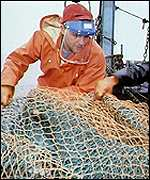 Trawlermen bring in the nets