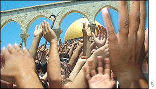 Palestinian worshippers near the Dome of the Rock mosque