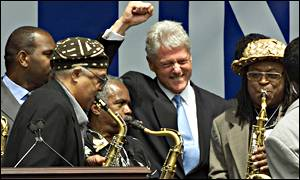 Former US President Bill Clinton is welcomed to Harlem