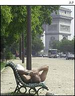 Man rests on bench in Avenue Foch