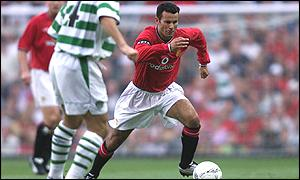 Ryan Giggs takes on Jackie McNamara