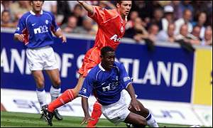 Russell Latapy in action against Aberdeen