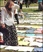 Srebrenica survivor examines victims' clothing