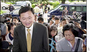 Prime Minister Thaksin Shinawatra is mobbed by reporters, August 2001