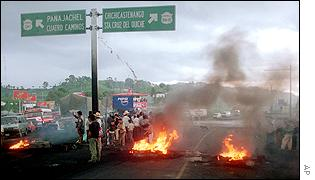 Protesters block the Panamerican Highway in Los Encuentros, Guatemala, 120km west of the capital