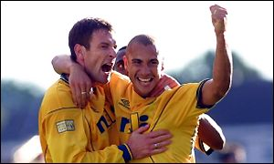 Sutton and Larsson celebrate the winning goal