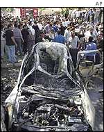 Wreckage of car destroyed in Israeli attack on a convoy carrying Barghouti in August 2000