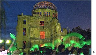 Peace activists wave lights at the Atomic Bomb Dome