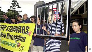 Greenpeace activists demonstrate outside US embassy in Tokyo