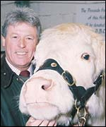 BBC presenter John Craven with Charolais heifer