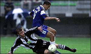 Newcastle's Wayne Quinn (left) halts Fabio's progress