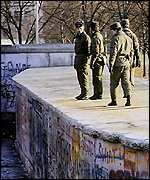 East German border guards on wall