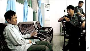Recent but undated photo of mining manager Li Dongming being questioned by police