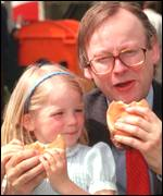 John Gummer, then Agriculture Minister, with his daughter Cordelia eating burgers in 1990