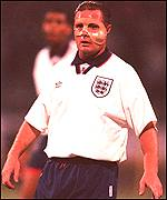 Paul Gascoigne wears a protective mask