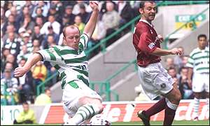 John Hartson tries his luck as Colin Cameron looks on