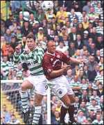 Chris Sutton and Steve Fulton joust for the ball