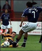 Stuart Lovell tries to stop Fabian Caballero