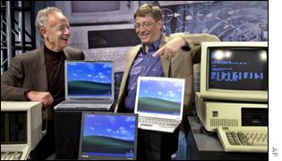 Andy Grove of Intel and Bill Gates from Microsoft pose with old and new computers
