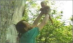 Father holding up baby