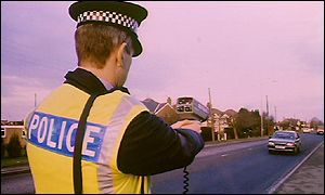 Traffic officer with mobile radar gun