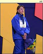 Olga Yegorova stands alone on the podium