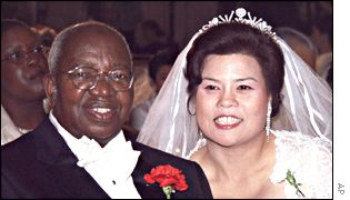 Archbishop Emmanuel Milingo marries Maria Sung in a Moonie ceremony in May