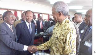 Mandela shaking hands